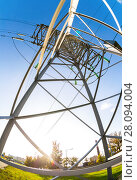 Купить «High voltage electric tower against the blue sky. Power transmission line», фото № 28094004, снято 8 октября 2017 г. (c) FotograFF / Фотобанк Лори