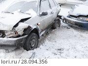 Купить «Two crashed cars in accident on winter road», фото № 28094356, снято 22 февраля 2018 г. (c) EugeneSergeev / Фотобанк Лори
