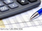 Купить «Калькулятор, таблица с цифрами и ручка», эксклюзивное фото № 28094556, снято 13 февраля 2018 г. (c) Юрий Морозов / Фотобанк Лори