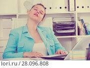 Купить «Office manager woman is sleeping after productive day at work», фото № 28096808, снято 9 июня 2017 г. (c) Яков Филимонов / Фотобанк Лори