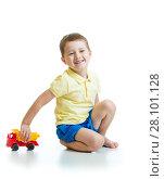 Купить «kid with toy isolated on a white background», фото № 28101128, снято 25 мая 2019 г. (c) Оксана Кузьмина / Фотобанк Лори