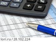 Купить «Калькулятор, таблица с цифрами и ручка», эксклюзивное фото № 28102224, снято 13 февраля 2018 г. (c) Юрий Морозов / Фотобанк Лори
