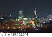 Купить «Kremlin wall, Spassky Tower being restored, Vasilevsky descent and St Basil Cathedral in Moscow, Russia at night», фото № 28102644, снято 15 октября 2019 г. (c) Losevsky Pavel / Фотобанк Лори