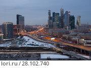 Купить «Third transport ring and skyscrapers at evening in Moscow, Russia», фото № 28102740, снято 28 февраля 2016 г. (c) Losevsky Pavel / Фотобанк Лори