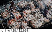 Купить «barbecue of pork cooked on the grill», видеоролик № 28112928, снято 10 июня 2017 г. (c) Володина Ольга / Фотобанк Лори
