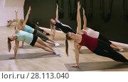 Купить «Smiling young women training yoga positions in modern yoga studio», видеоролик № 28113040, снято 14 февраля 2018 г. (c) Яков Филимонов / Фотобанк Лори