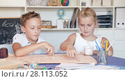 Купить «Boy with sister are playing in game at home.», видеоролик № 28113052, снято 11 августа 2017 г. (c) Яков Филимонов / Фотобанк Лори