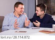 Купить «Adult male with his son are resting together and talking about teenage secrets», фото № 28114872, снято 5 февраля 2018 г. (c) Яков Филимонов / Фотобанк Лори