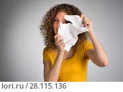 Купить «woman furiously tore the paper», фото № 28115136, снято 29 января 2018 г. (c) Типляшина Евгения / Фотобанк Лори