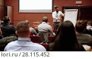 Купить «Public speaker giving talk at business event», видеоролик № 28115452, снято 5 апреля 2020 г. (c) Matej Kastelic / Фотобанк Лори
