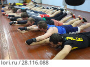 Купить «MOSCOW - FEB 9, 2017: Young men do exercises on floor in Dobrynya boxing club», фото № 28116088, снято 9 февраля 2017 г. (c) Losevsky Pavel / Фотобанк Лори