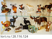 Купить «MOSCOW, RUSSIA - OCT 28, 2016: Many different figurines of elk by Verbilki Porcelain Factory inside glass box at private collection», фото № 28116124, снято 28 октября 2016 г. (c) Losevsky Pavel / Фотобанк Лори