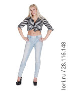 Купить «Young pretty blonde in jeans poses isolated on white background», фото № 28116148, снято 31 октября 2016 г. (c) Losevsky Pavel / Фотобанк Лори