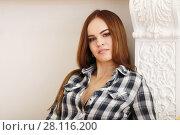 Купить «Young beautiful smiling woman in shirt poses near stucco molding in studio», фото № 28116200, снято 31 октября 2016 г. (c) Losevsky Pavel / Фотобанк Лори