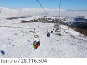 Купить «People ride on cableway at winter day in Cahkadzor resort in mountains; Hrazdan town far away», фото № 28116504, снято 7 января 2017 г. (c) Losevsky Pavel / Фотобанк Лори