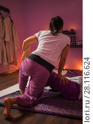 Купить «Asian woman does thai massage for woman on mat in room, back view», фото № 28116624, снято 13 декабря 2016 г. (c) Losevsky Pavel / Фотобанк Лори
