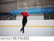 Купить «Young slim dancing woman during jump on skate in indoor ice rink», фото № 28116652, снято 26 января 2017 г. (c) Losevsky Pavel / Фотобанк Лори