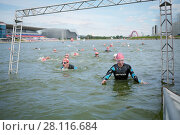 Купить «MOSCOW, RUSSIA - AUG 14, 2016: Participants of swimming stage of traditional 3Grom series triathlon contest in Krylatskoye Rowing Channel», фото № 28116684, снято 14 августа 2016 г. (c) Losevsky Pavel / Фотобанк Лори