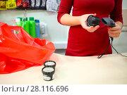 Купить «Red bag, female hands register purchase, plastic jars are on table in supermarket, noface», фото № 28116696, снято 14 октября 2016 г. (c) Losevsky Pavel / Фотобанк Лори