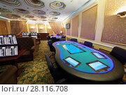 Купить «Empty casino with electronic table and electronic gaming machines», фото № 28116708, снято 17 октября 2016 г. (c) Losevsky Pavel / Фотобанк Лори