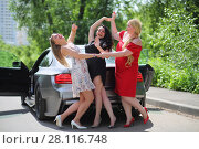 Купить «MOSCOW - JUN 19, 2016: Three happy beautiful girls (with model releases) with long hair cheerfully laughing and fooling near the sport car in front of green foliage», фото № 28116748, снято 19 июня 2016 г. (c) Losevsky Pavel / Фотобанк Лори