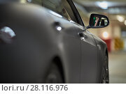 Купить «Right side of modern car at underground parking, focus on rear view mirror», фото № 28116976, снято 11 ноября 2015 г. (c) Losevsky Pavel / Фотобанк Лори