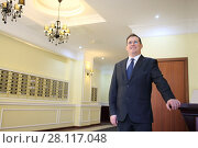 Купить «Portrait of a man in a business suit and tie near workplace in a lobby», фото № 28117048, снято 21 февраля 2016 г. (c) Losevsky Pavel / Фотобанк Лори