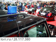 Купить «MOSCOW - MAR 07, 2016: Flasher on black car at exhibition Oldtimer-Gallery in Sokolniki Exhibition Center. It is only one in Russia exhibition of vintage cars and technical antiques», фото № 28117380, снято 7 марта 2016 г. (c) Losevsky Pavel / Фотобанк Лори