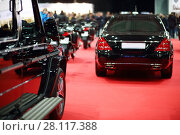 Купить «Black shiny cars are on red carpet in hall at auto exhibition», фото № 28117388, снято 7 марта 2016 г. (c) Losevsky Pavel / Фотобанк Лори