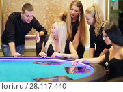 Купить «Four young women and man play poker in casino with electronic table, focus on two blonds, man», фото № 28117440, снято 24 октября 2016 г. (c) Losevsky Pavel / Фотобанк Лори