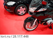 Купить «Black shiny bike for cortege, car are on red carpet in exhibition hall», фото № 28117448, снято 7 марта 2016 г. (c) Losevsky Pavel / Фотобанк Лори