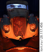 Купить «MOSCOW - MAR 07, 2016: Dirty retro car on exhibition Oldtimer-Gallery in Sokolniki Exhibition Center. It is only one in Russia exhibition of vintage cars and technical antiques», фото № 28117456, снято 7 марта 2016 г. (c) Losevsky Pavel / Фотобанк Лори