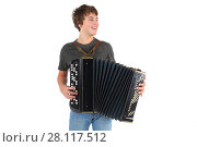 Купить «Happy young boy plays accordion and smiles isolated on white background», фото № 28117512, снято 20 ноября 2015 г. (c) Losevsky Pavel / Фотобанк Лори
