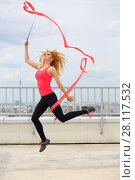 Купить «Beautiful blonde jumping with red curly ribbon on the roof of a multistory building», фото № 28117532, снято 30 июля 2015 г. (c) Losevsky Pavel / Фотобанк Лори