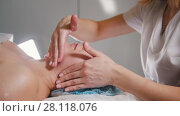 Купить «Professional cosmetic procedure for skin of face - mask facial massage at spa salon skincare», видеоролик № 28118076, снято 23 мая 2018 г. (c) Константин Шишкин / Фотобанк Лори