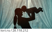 Купить «Woman playing with a baby», видеоролик № 28118212, снято 21 февраля 2018 г. (c) Илья Шаматура / Фотобанк Лори