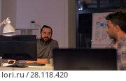 Купить «creative team with computer working late at office», видеоролик № 28118420, снято 29 января 2018 г. (c) Syda Productions / Фотобанк Лори
