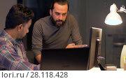 Купить «creative team with computer working late at office», видеоролик № 28118428, снято 29 января 2018 г. (c) Syda Productions / Фотобанк Лори