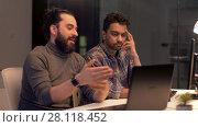 Купить «creative team with computer working late at office», видеоролик № 28118452, снято 29 января 2018 г. (c) Syda Productions / Фотобанк Лори
