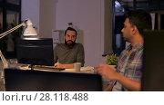 Купить «creative team with computer working late at office», видеоролик № 28118488, снято 29 января 2018 г. (c) Syda Productions / Фотобанк Лори