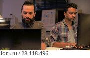 Купить «creative team with computer working late at office», видеоролик № 28118496, снято 29 января 2018 г. (c) Syda Productions / Фотобанк Лори