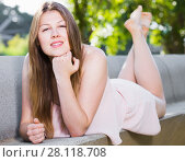 Купить «Elegant female is posing on bench in her free time», фото № 28118708, снято 10 июня 2017 г. (c) Яков Филимонов / Фотобанк Лори