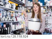 Купить «buyer in delight from electronics devices», фото № 28118924, снято 12 декабря 2017 г. (c) Яков Филимонов / Фотобанк Лори