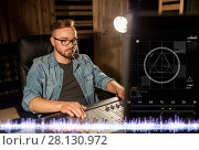 Купить «man at mixing console in music recording studio», фото № 28130972, снято 18 августа 2016 г. (c) Syda Productions / Фотобанк Лори