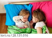 Купить «happy little girls sleeping in bed at home», фото № 28131016, снято 15 октября 2017 г. (c) Syda Productions / Фотобанк Лори