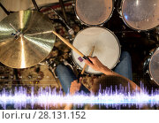 Купить «drummer playing drum kit at sound recording studio», фото № 28131152, снято 18 августа 2016 г. (c) Syda Productions / Фотобанк Лори
