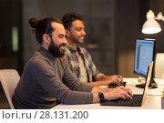 Купить «creative team with computers working at office», фото № 28131200, снято 24 января 2018 г. (c) Syda Productions / Фотобанк Лори