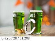 Купить «glass of green beer, horseshoe and gold coins», фото № 28131208, снято 31 января 2018 г. (c) Syda Productions / Фотобанк Лори