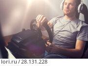 Купить «close up of man playing car racing video game», фото № 28131228, снято 12 марта 2016 г. (c) Syda Productions / Фотобанк Лори