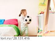 Купить «happy little girl with socker ball at home», фото № 28131416, снято 15 октября 2017 г. (c) Syda Productions / Фотобанк Лори